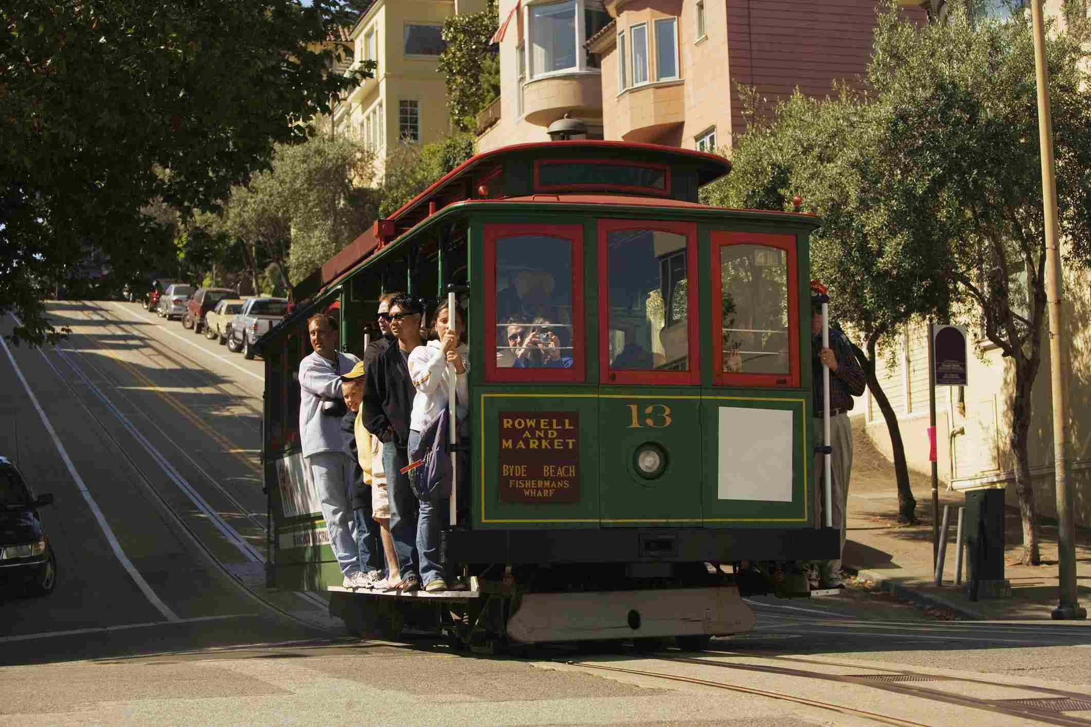A historic San Francisco cable car heading toward Fisherman's Wharf