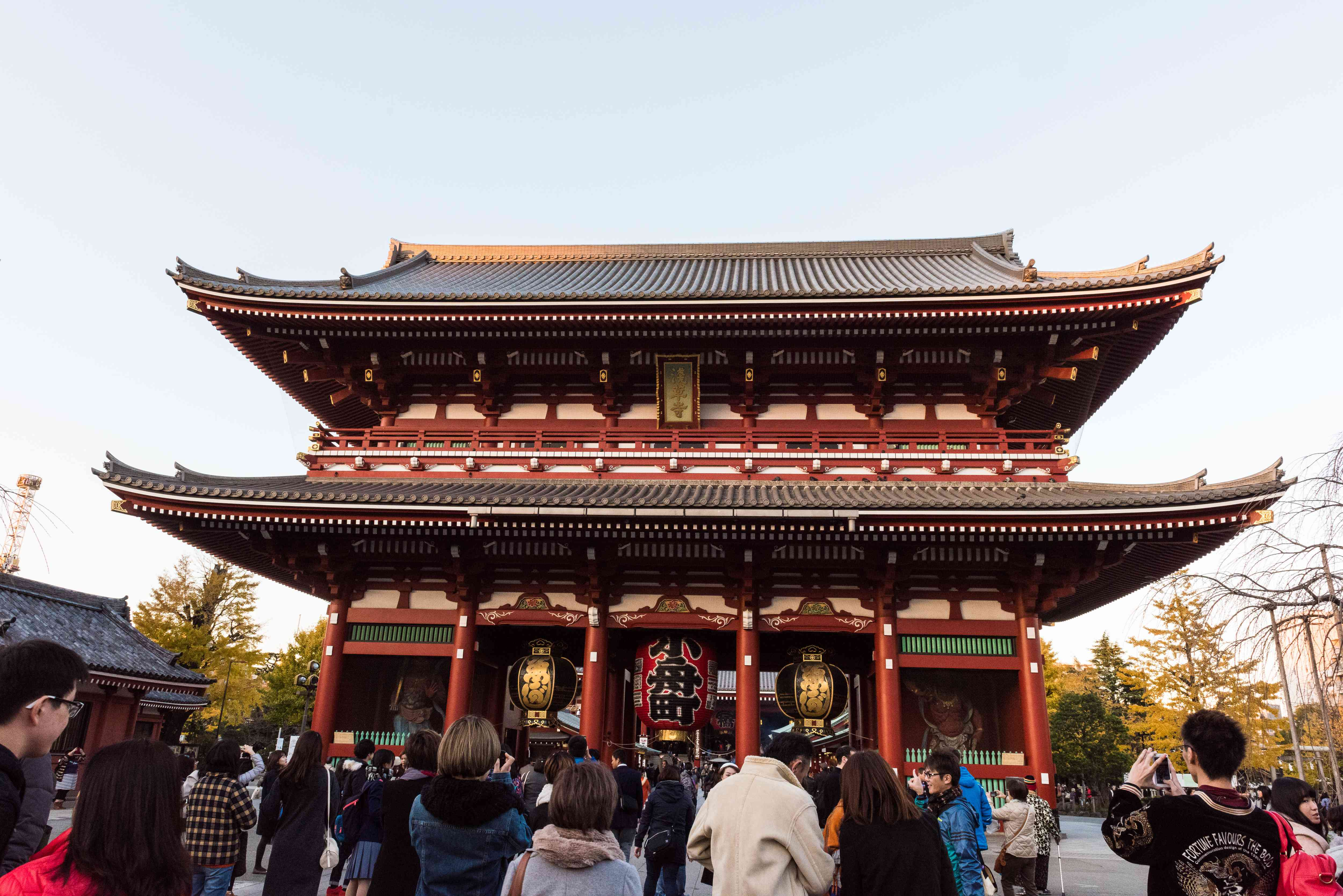 Senso-ji temple in tokyo with people taking photos of the entry gate