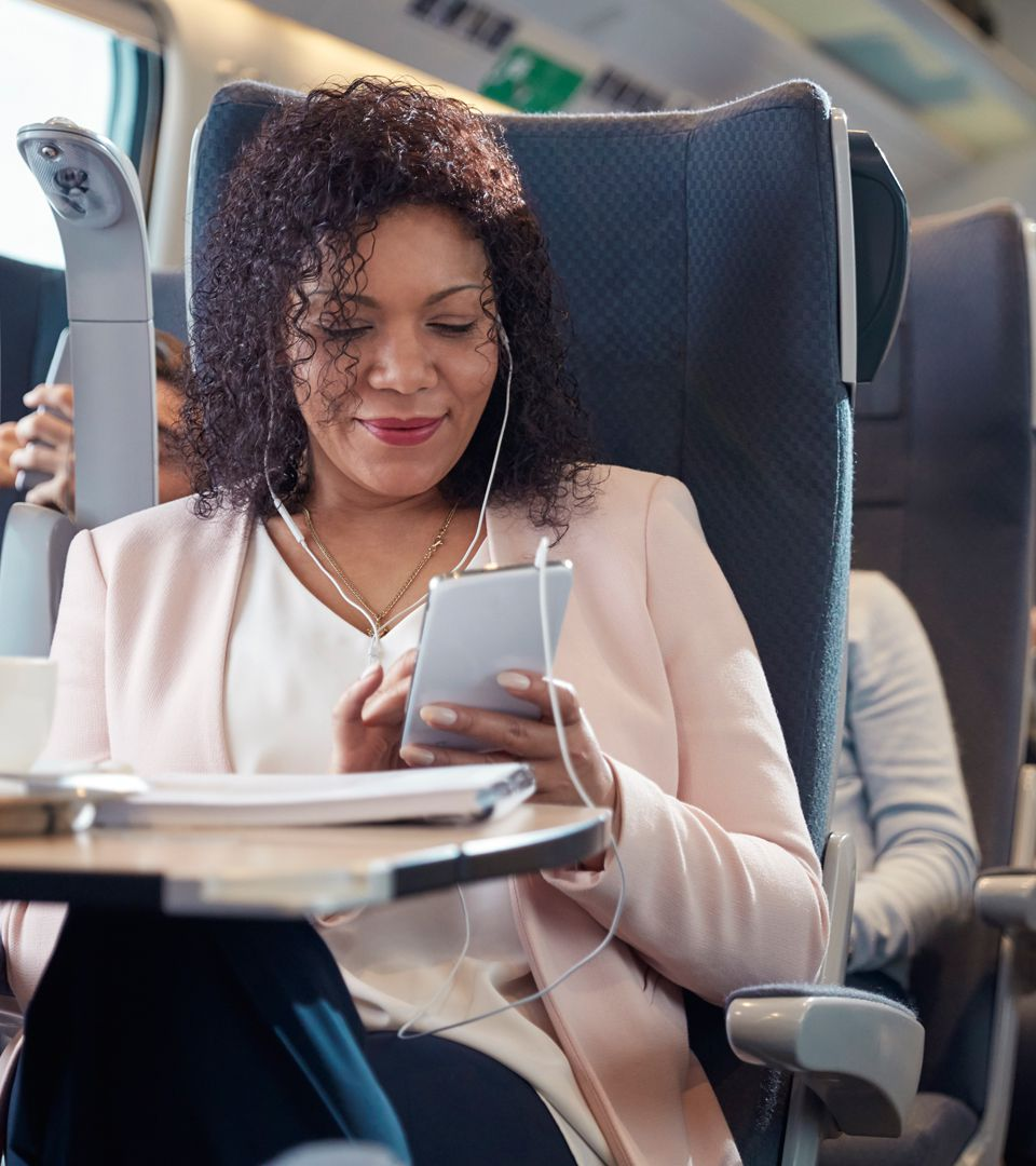 Woman looking at phone on airplane