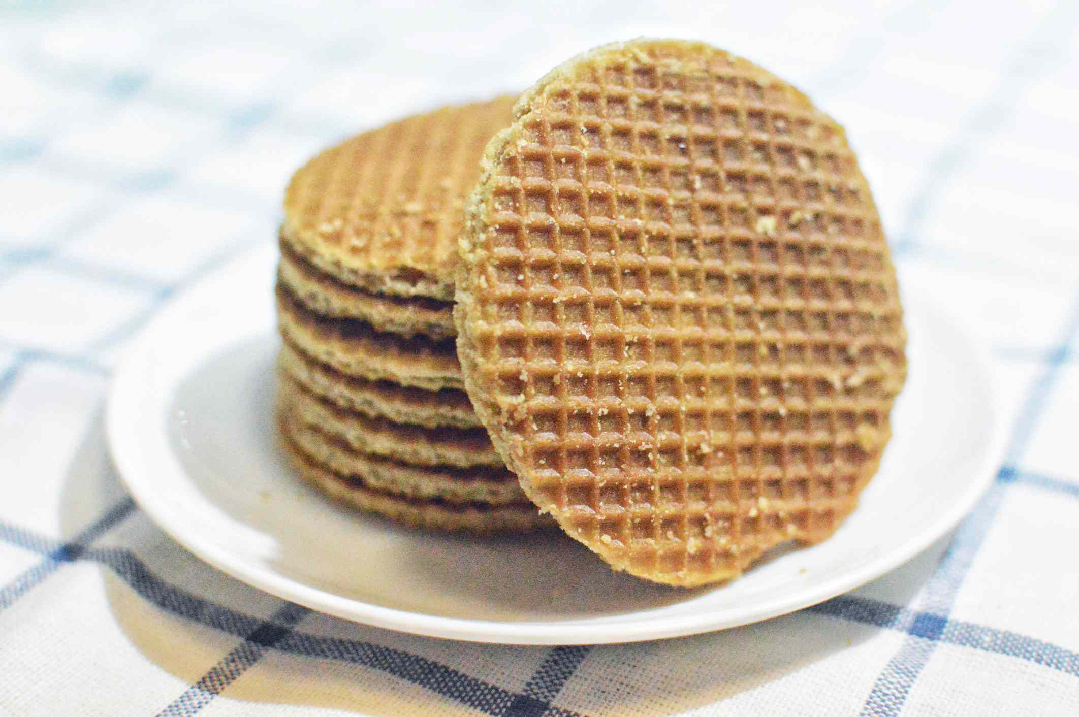 Stack of Dutch caramel waffles on a plate.