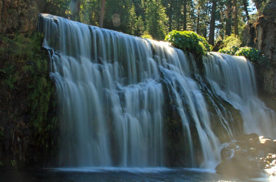 A waterfall on a sunny day.