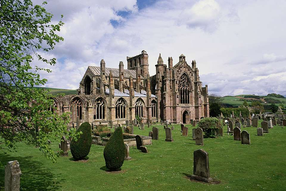a small cemetery beside the stone ruins of Melrose Abbey