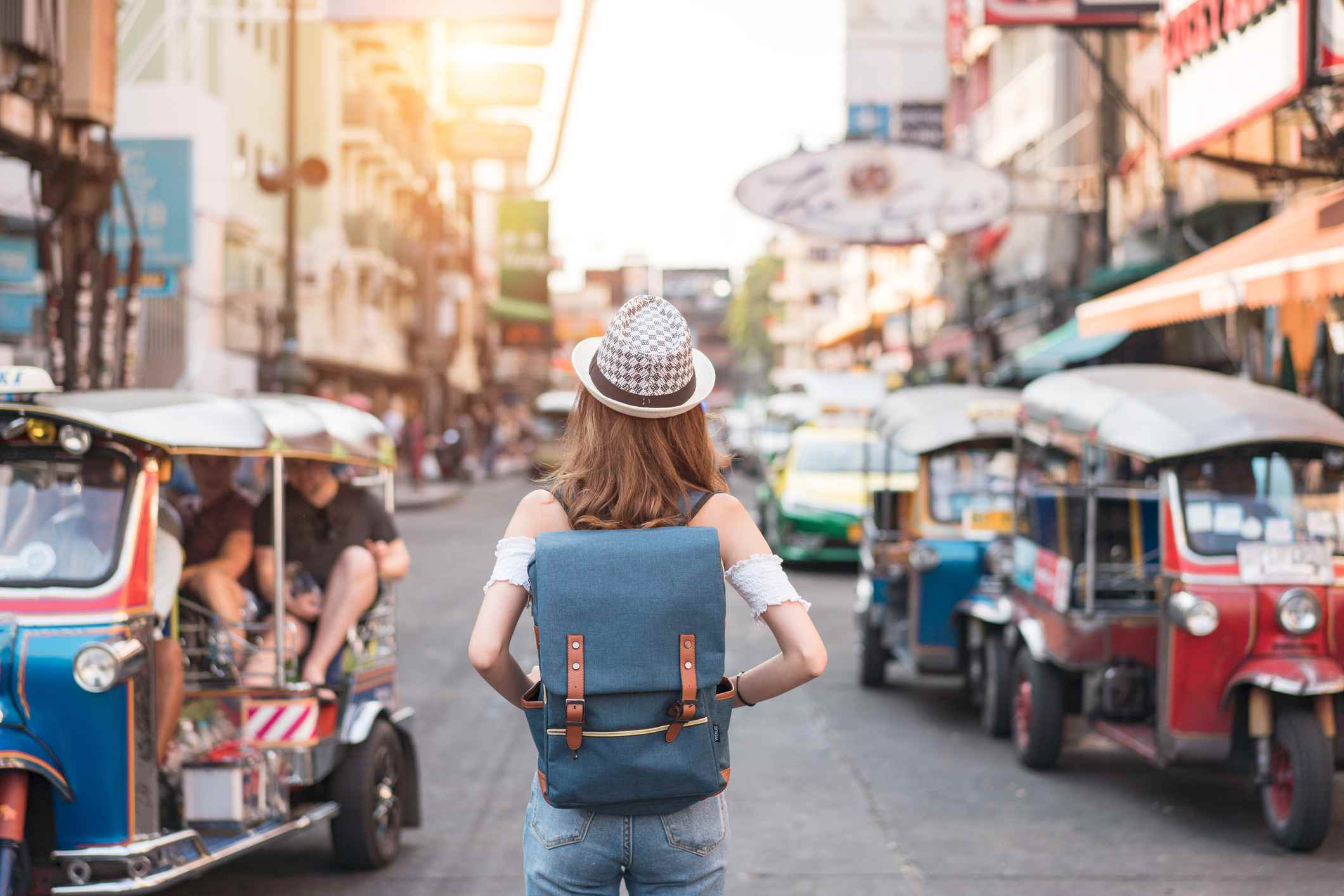 A traveler stands on the street in Bangkok, Thailand
