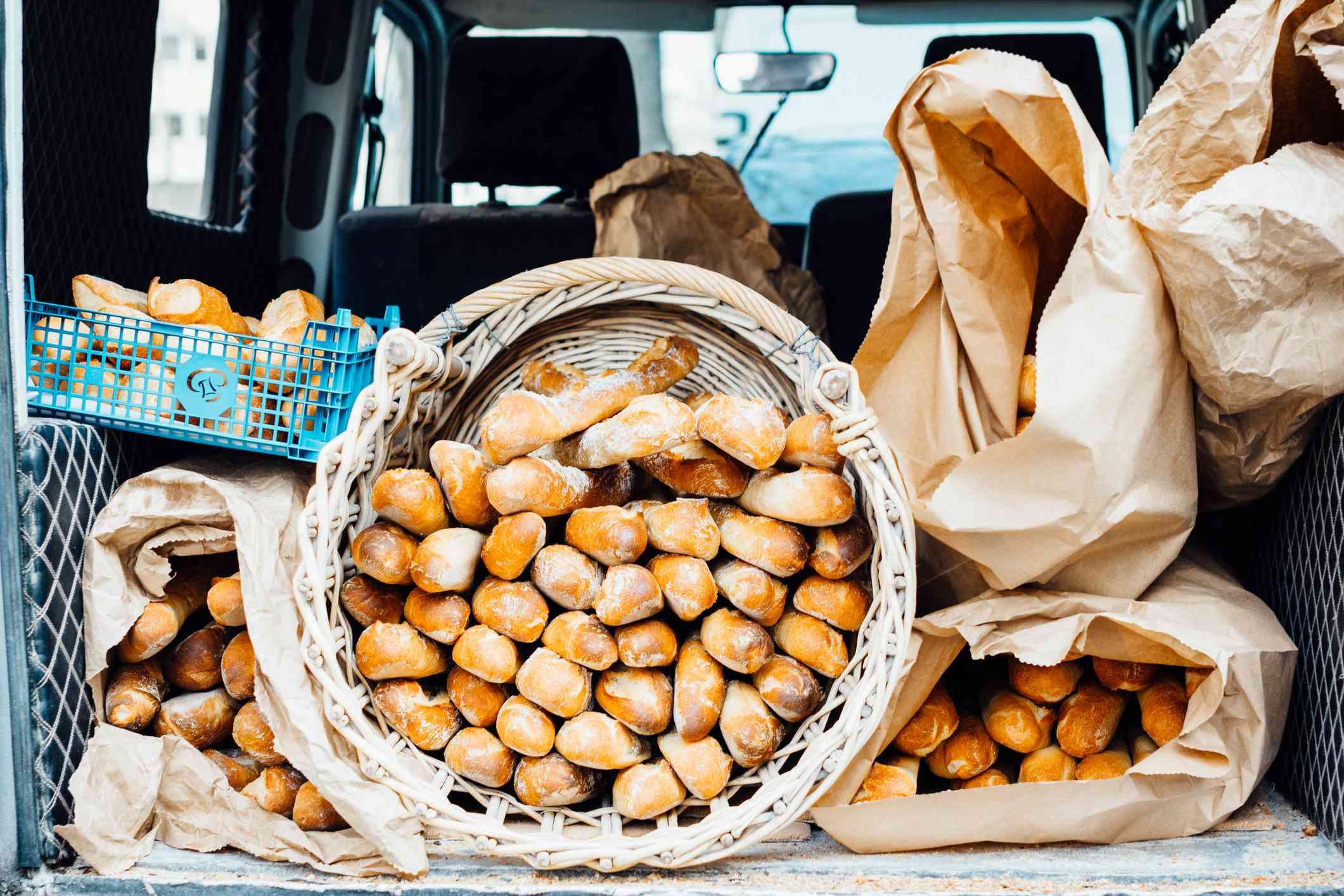 Car carrying baguettes in Paris, France