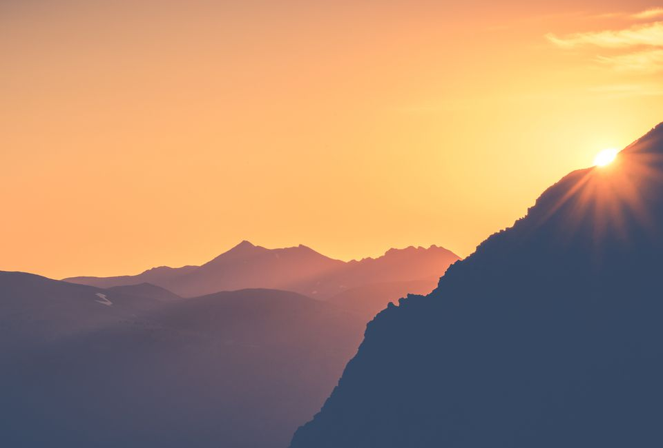 Scenic View Of Silhouetted Mountains At Dusk