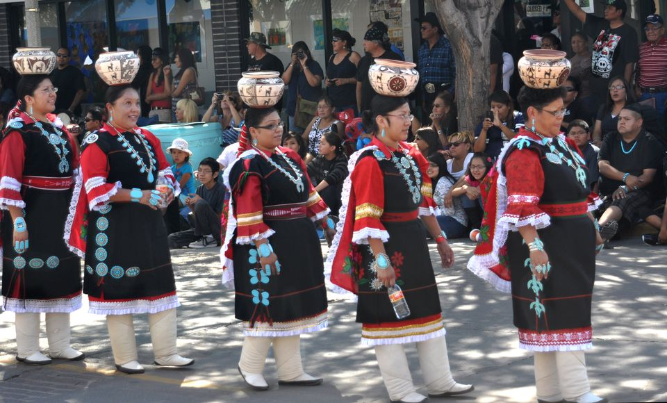 The Zuni Olla Maidens from Zuni Pueblo, carrying decorated handmade pottery on their heads, participate in the annual Inter-Tribal Indian Ceremonial parade in downtown Gallup, New Mexico