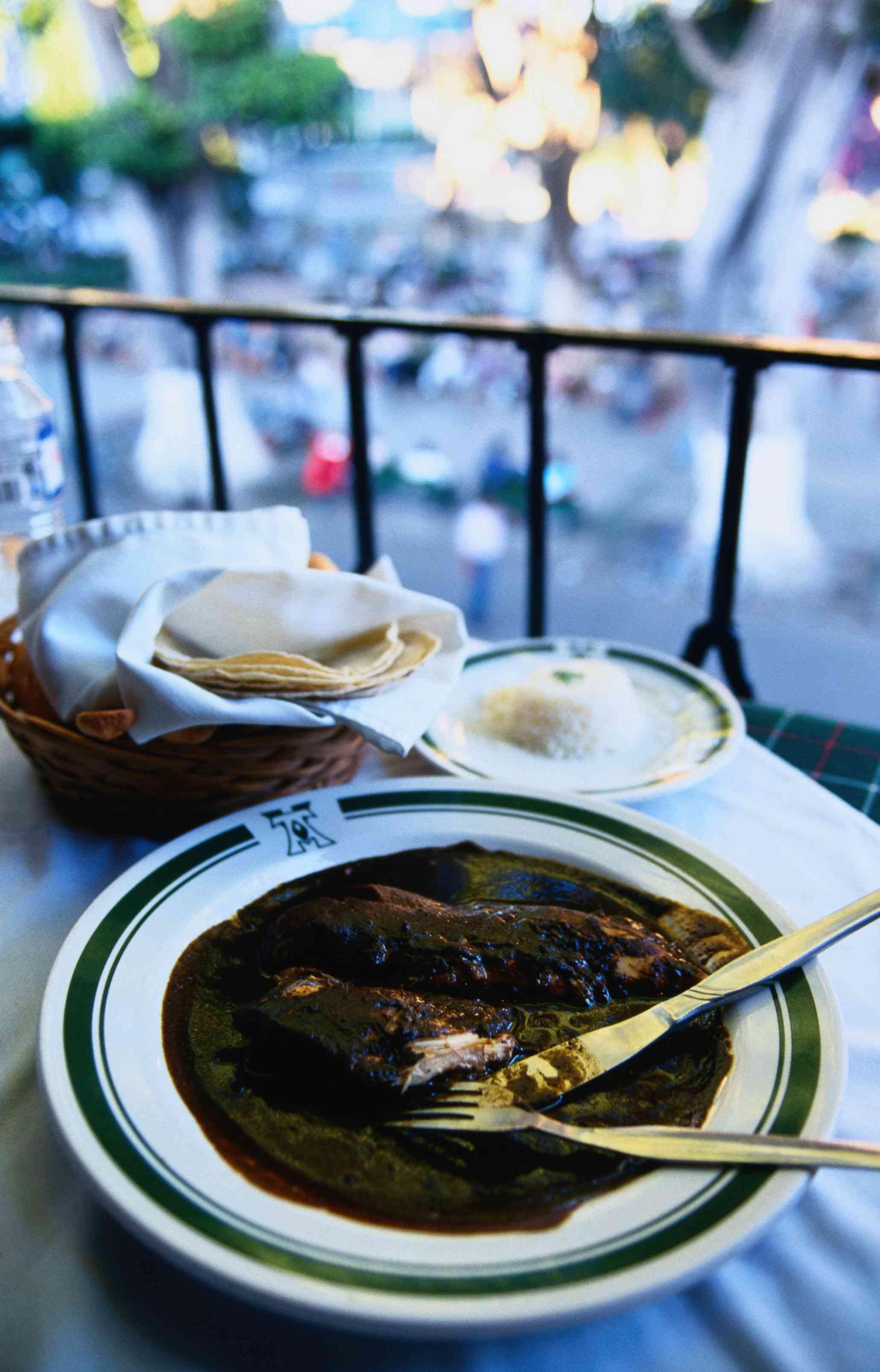 Pollo con Mole Negro served on a terrace overlooking Oaxaca's Zocalo