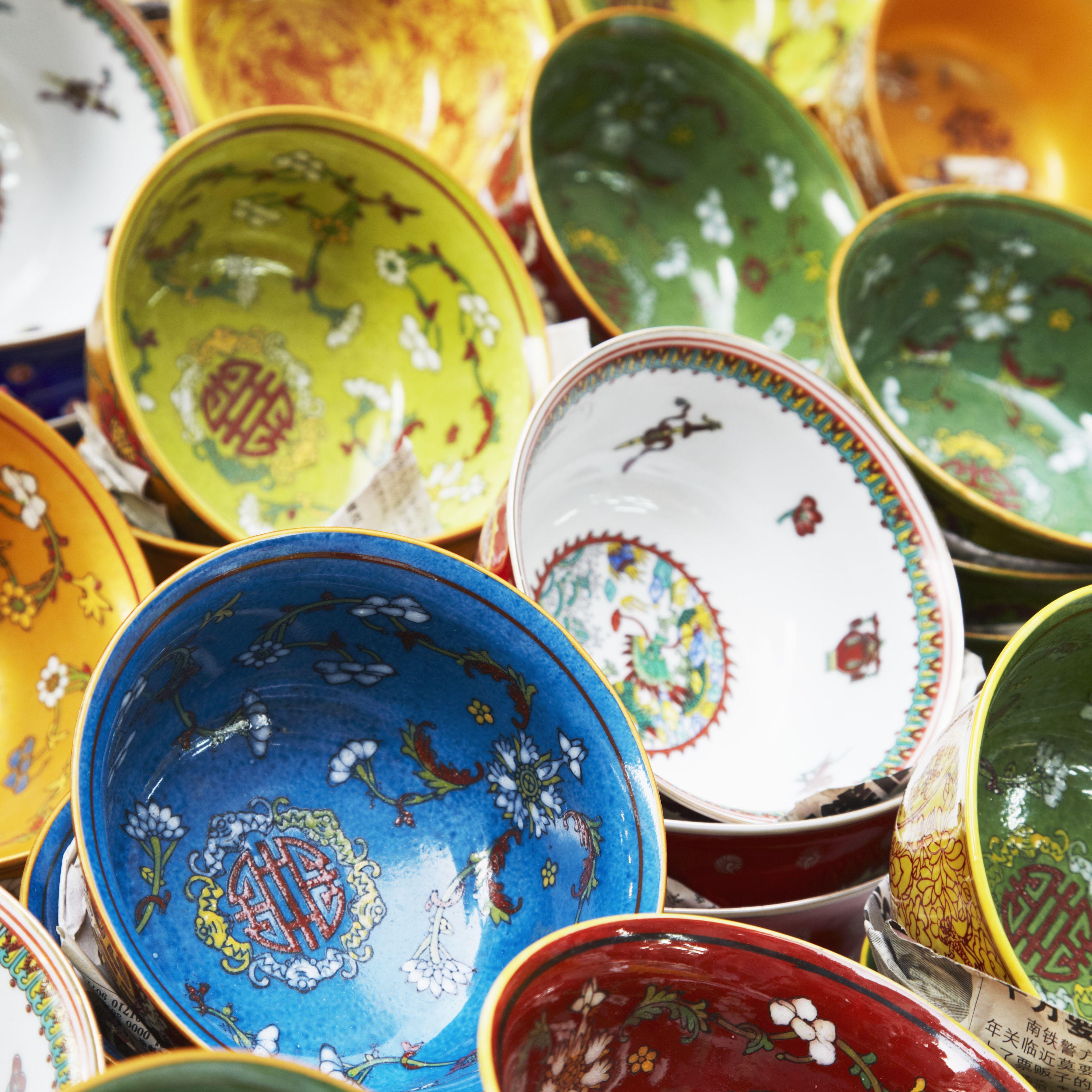 China, Hong Kong, Colorful Chinese bowls on market stall on Upper Lascar Row (Cat Street)