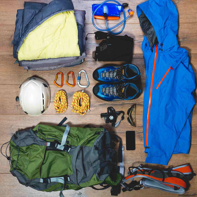 Climbing equipment displayed against wood floor.