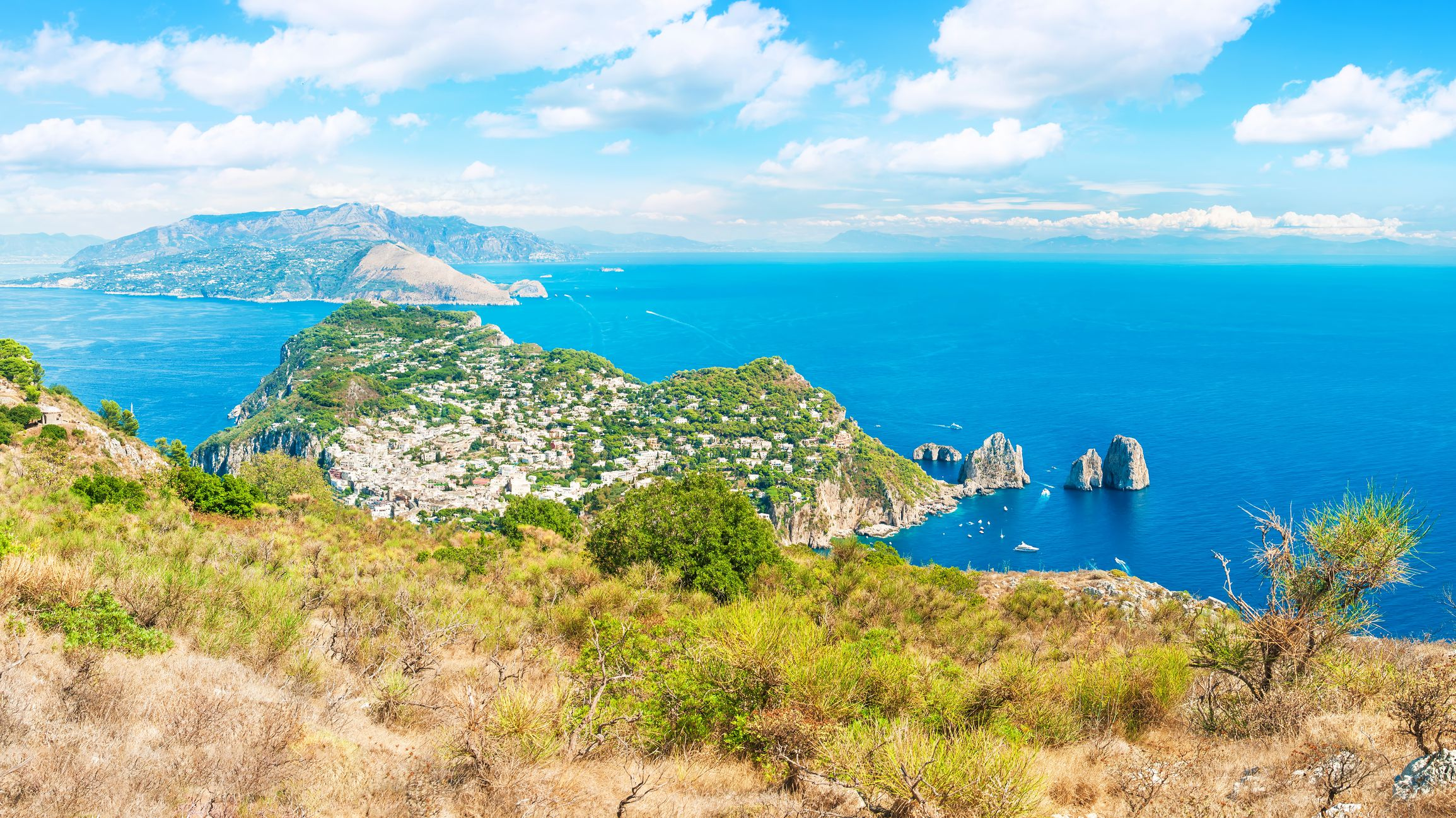 panoramic view of sea, city and mountains