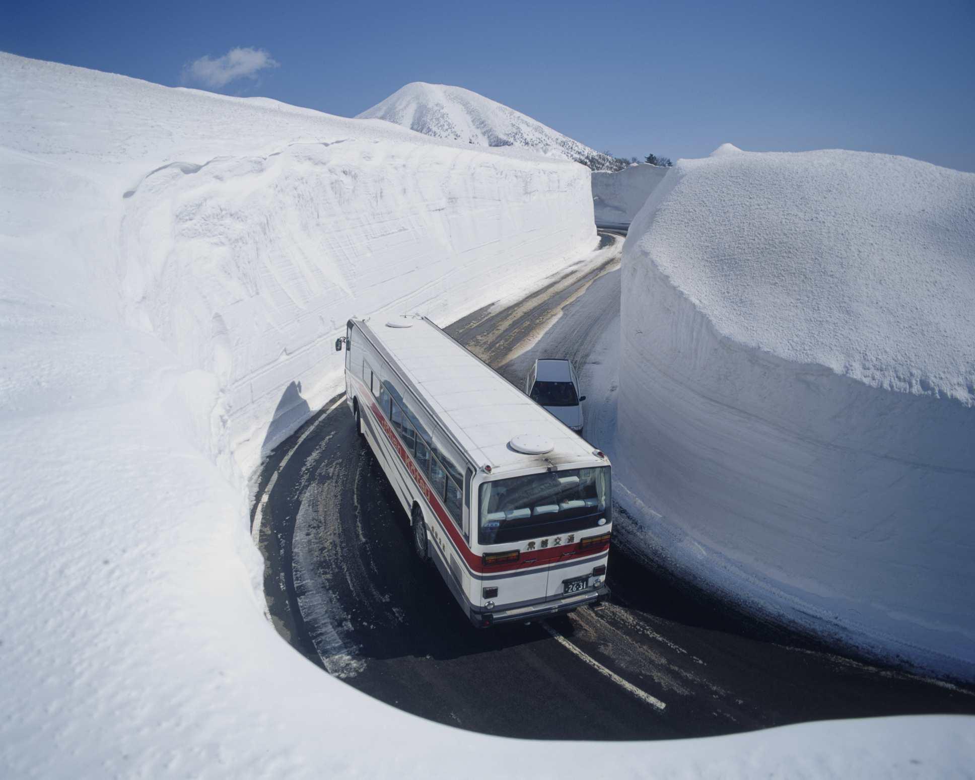 Bus on Snow mountain road, Aomori prefecture, Japan