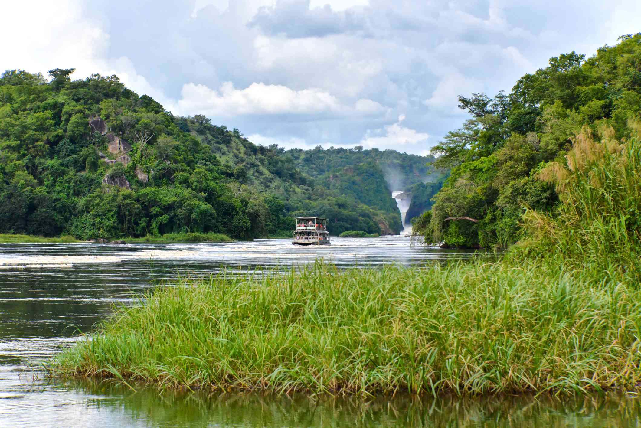 River boat on the Victoria Nile with Murchison Falls in the background