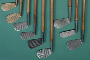 Right to left: waffle face; mesh ball face; Spalding Crowfly Waterfall; McGregor backspin mashie; Wilsonian mashie; Spalding Crowflight; McGill medal mashie niblick; Diamond mid-iron, combined brick face and deep groove.