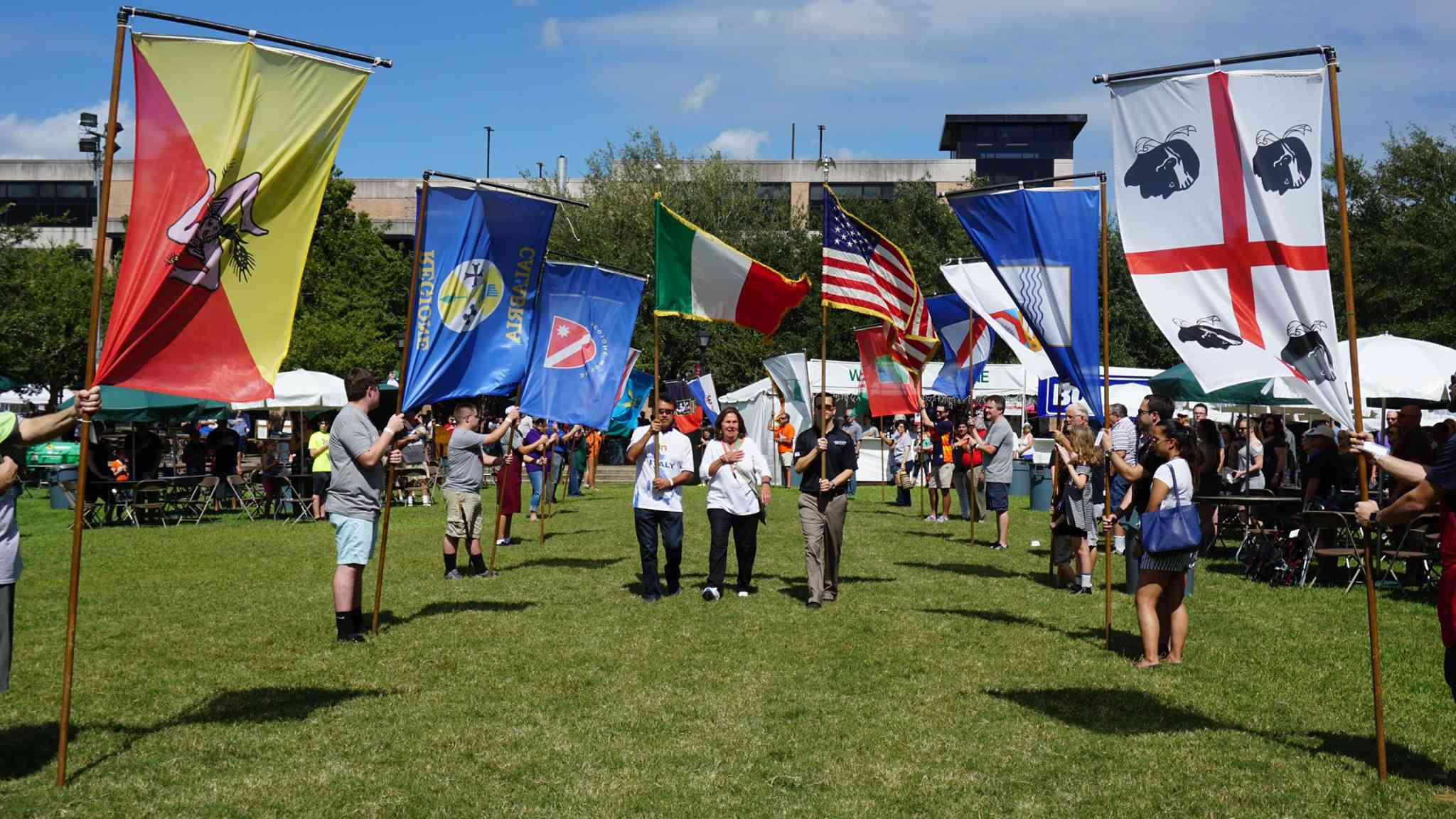 People holding flags at the Italian Festival