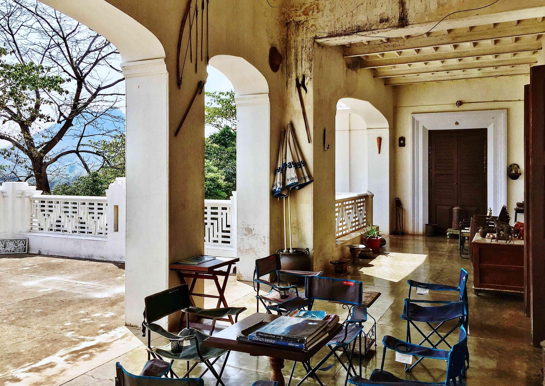 partially covered patio with a table in Gajalaxmi Palace, Odisha