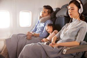 Happy family on plane
