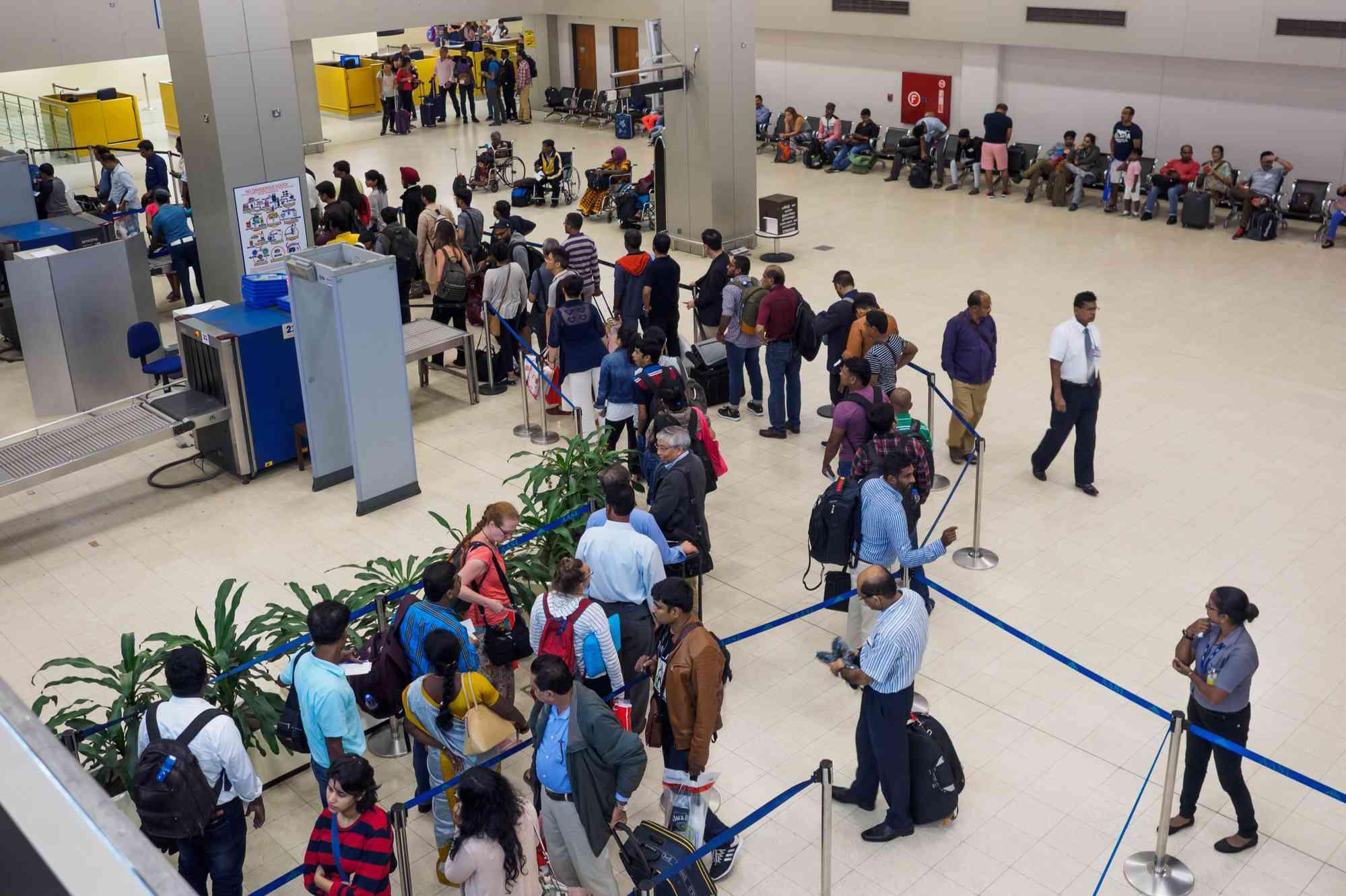 Passengers waiting in the queue for security check at Sri Lanka Bandaranaike International Airport