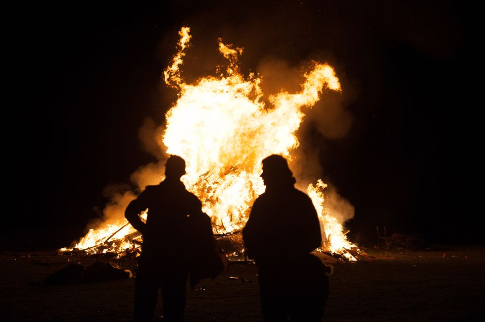 Two people in front of a bonfire on Halloween night in Bray, Wicklow, Ireland