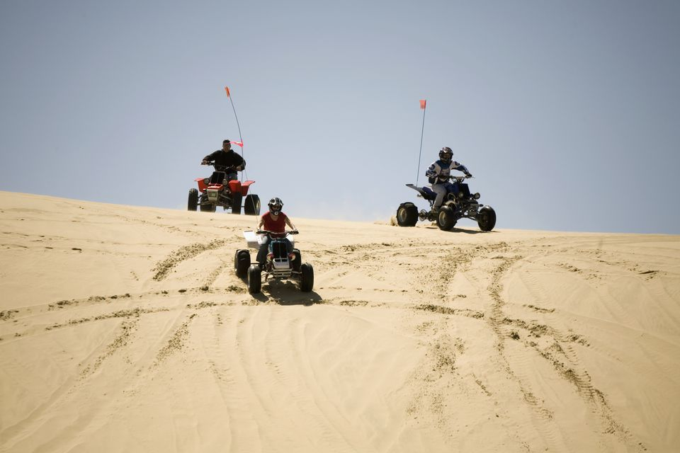 All-Terrain Vehicles Hitting the Dunes