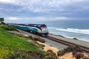 Coaster Commuter train on Del Mar beach, California, USA
