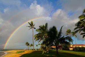 rainbow over Poipu Beach, Koloa, Kauai, Hawaii