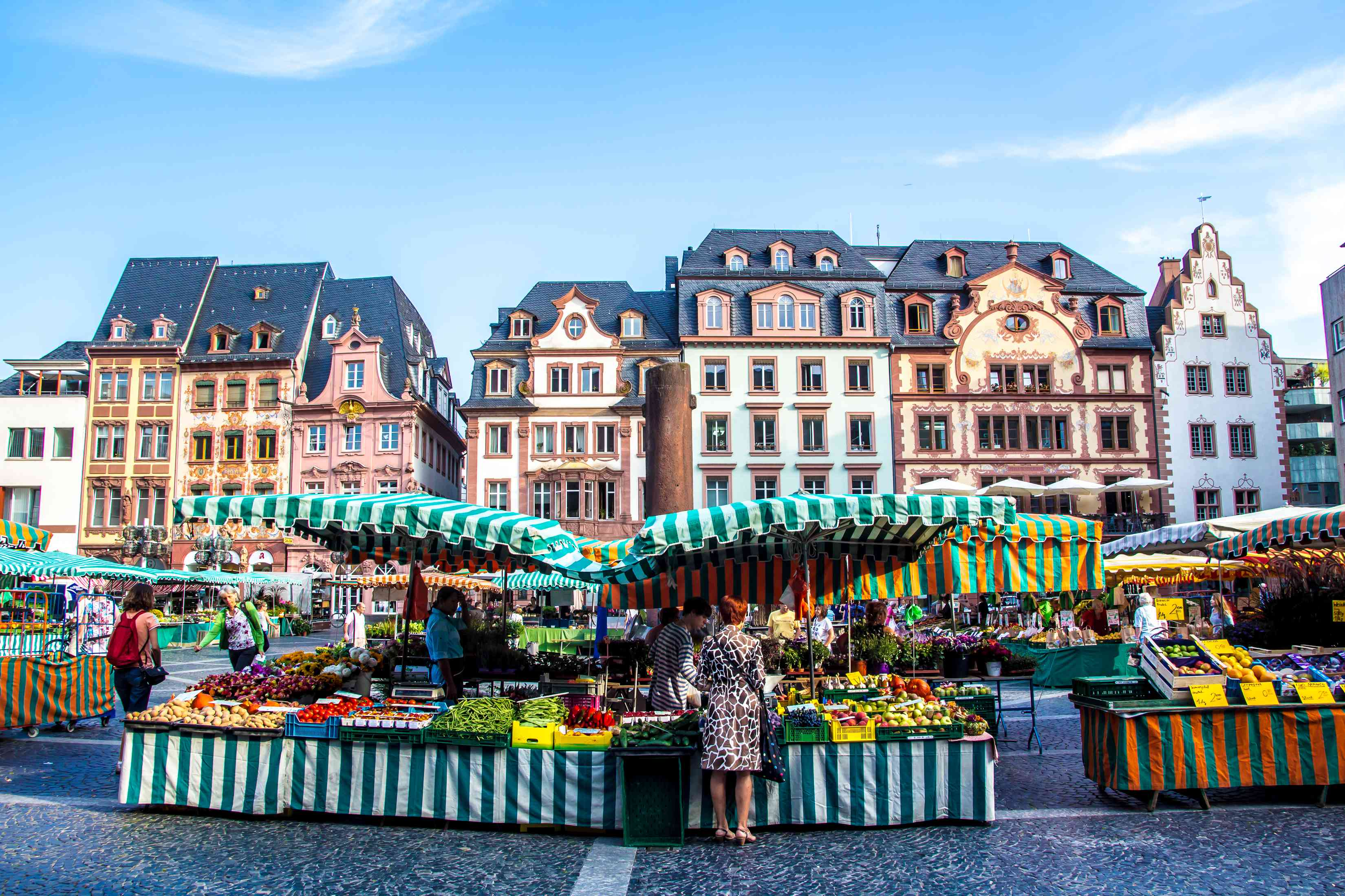 People shopping at colorful market stalls in mainz, Germany