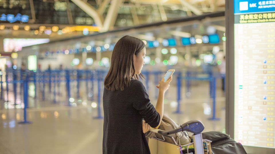 Girl using portable device in Shanghai Airport