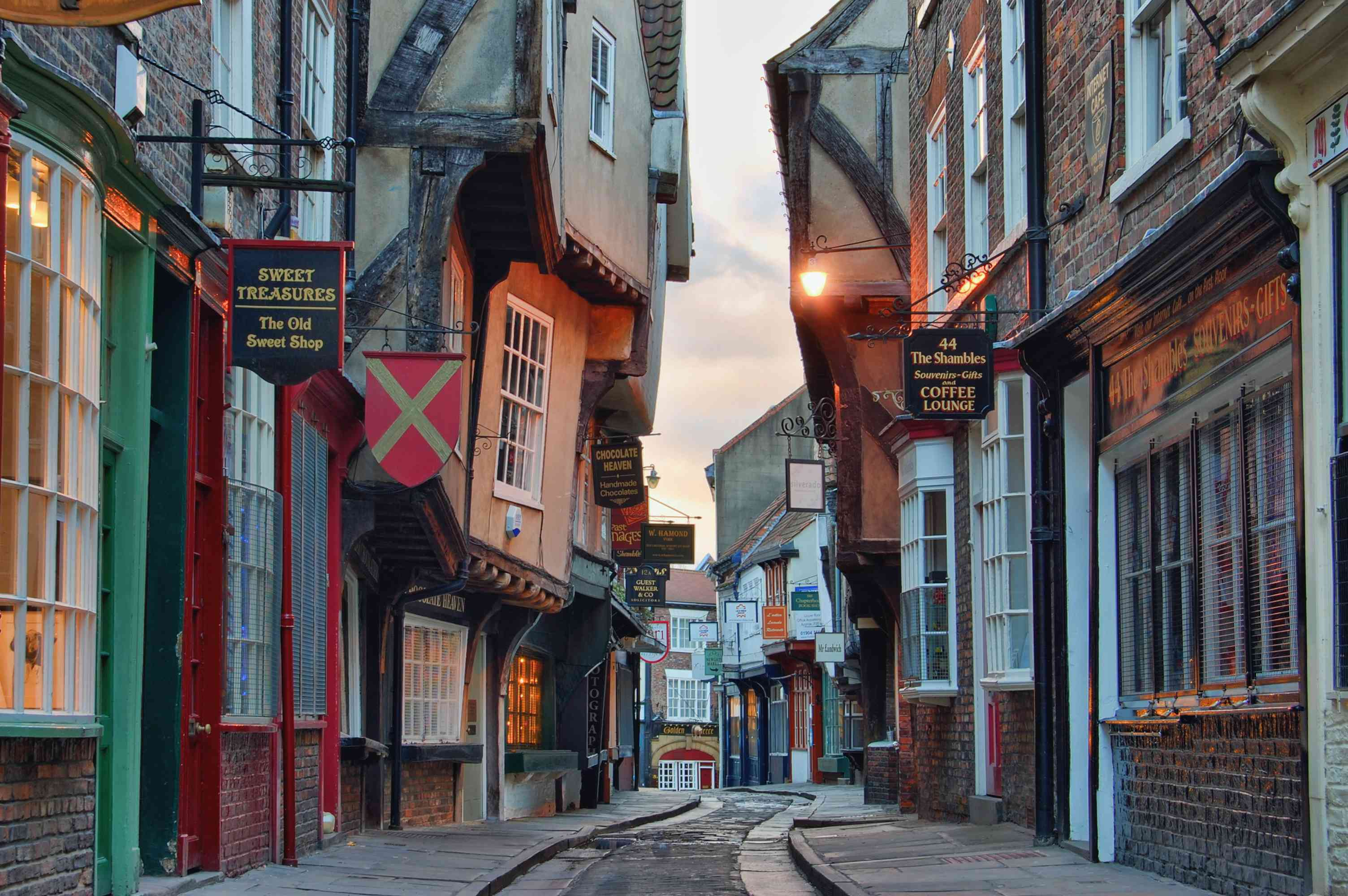 Narrow street with irregularly shaped buildings in in the York shambles at dusk