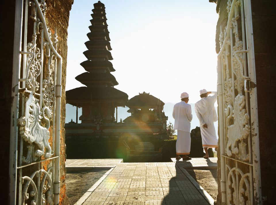 Bali, Indonesia, Ulu Danu Temple, two men on temple grounds