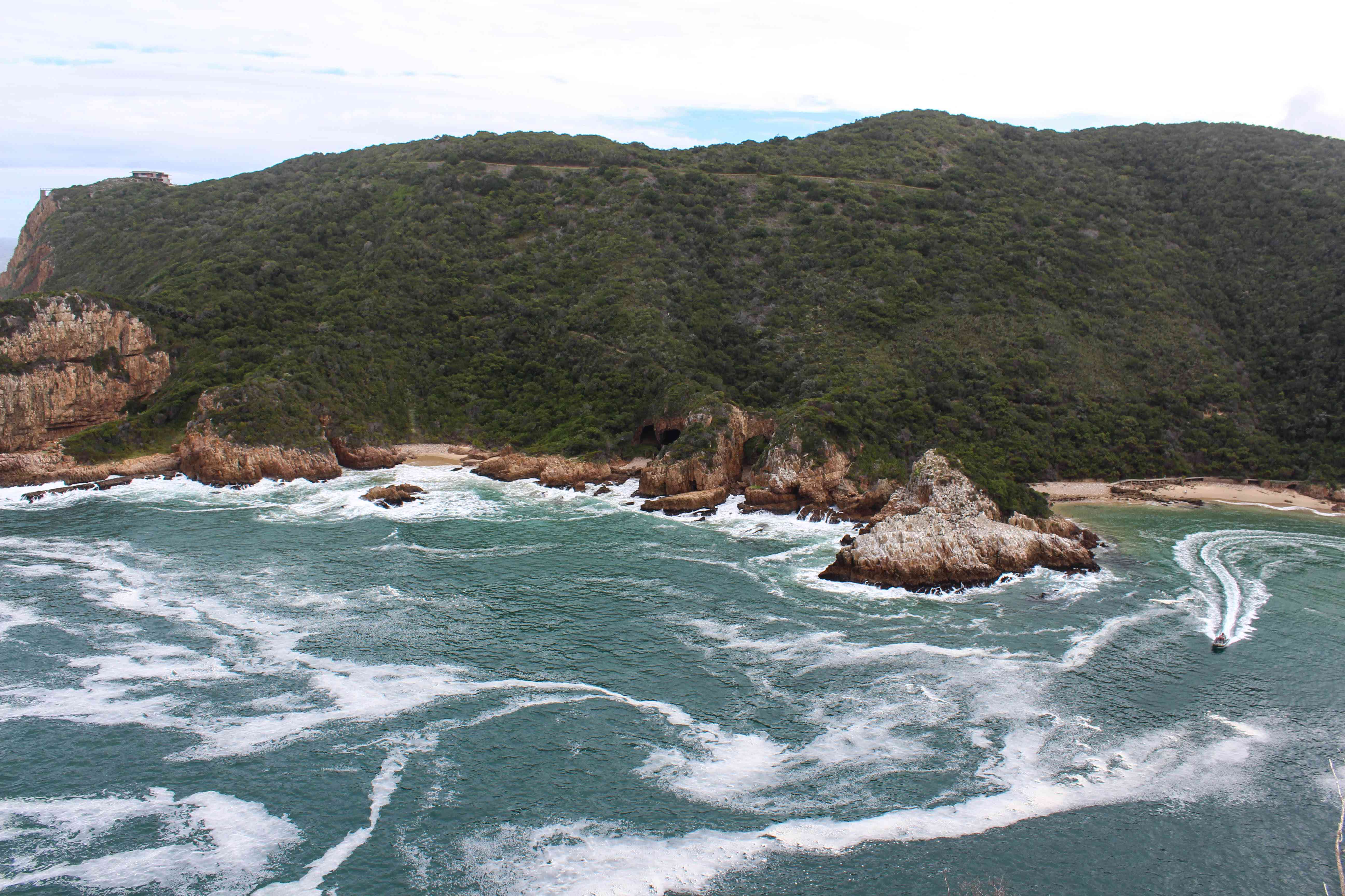 Aerial view of Knysna with waters swirling off the shore