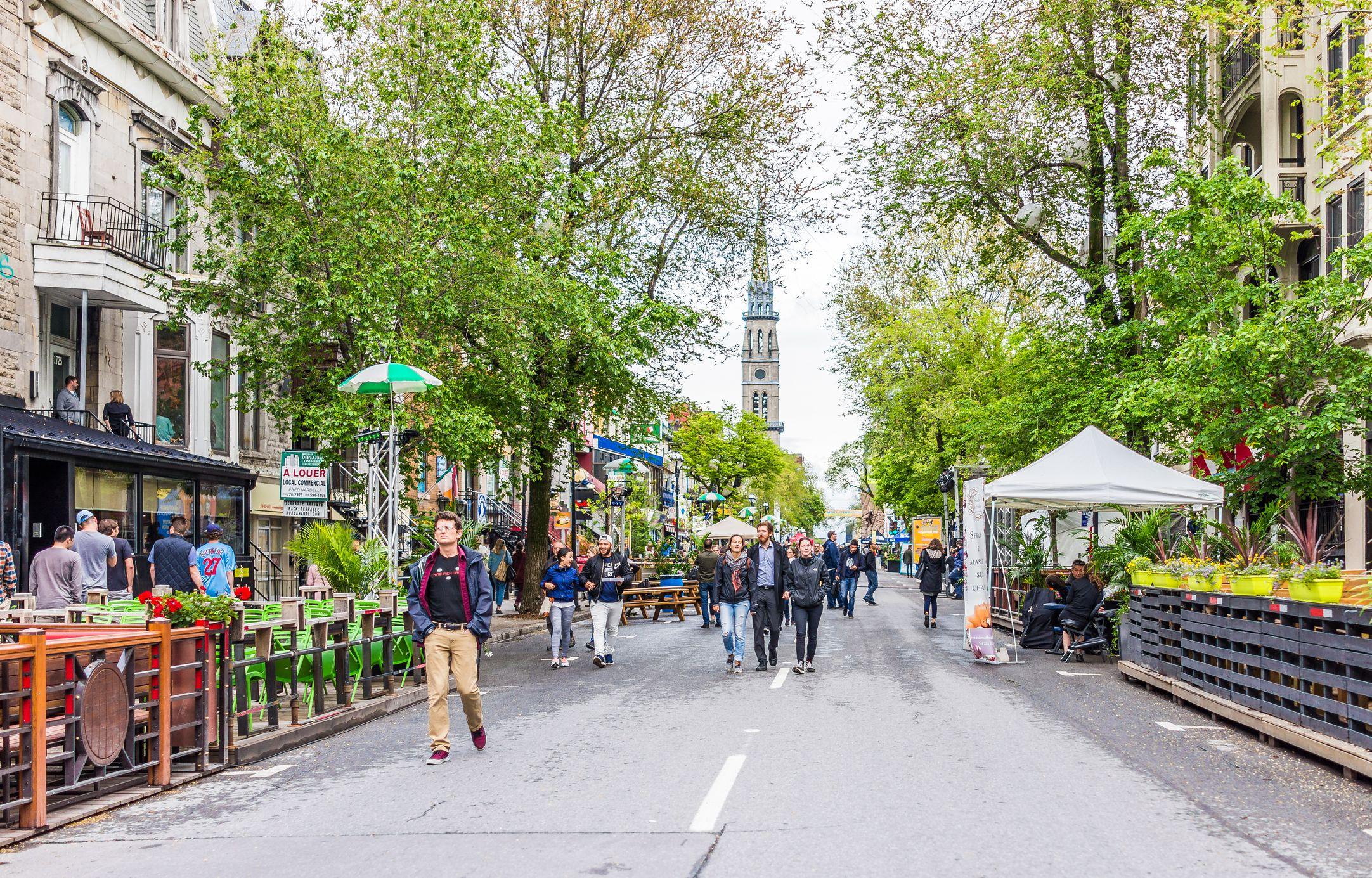 People walking on Saint Denis street in Montreal's Plateau Mont Royal in Quebec region