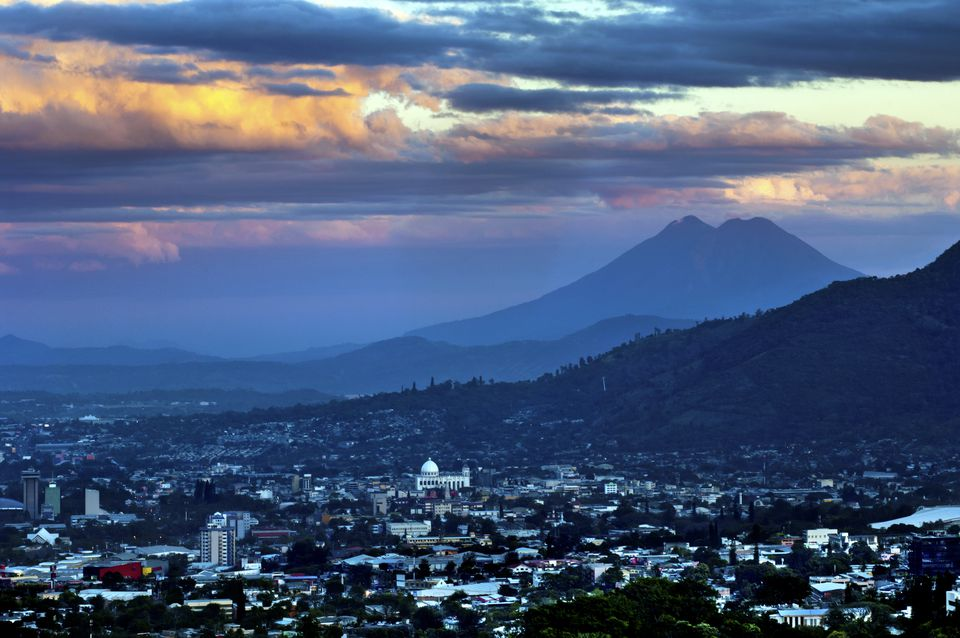 El Salvador, San Salvador, View of Boqueron Volcano Valley, Valley Of Hammocks, San Vincente Volcano and Metropolitan Cathedral Of Holy Savior at sunset