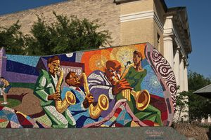 ??Rhapsody?? tile mosaic mural by John Yancey, in the Dr. Charles E. Urdy Plaza at East 11th and Waller streets.