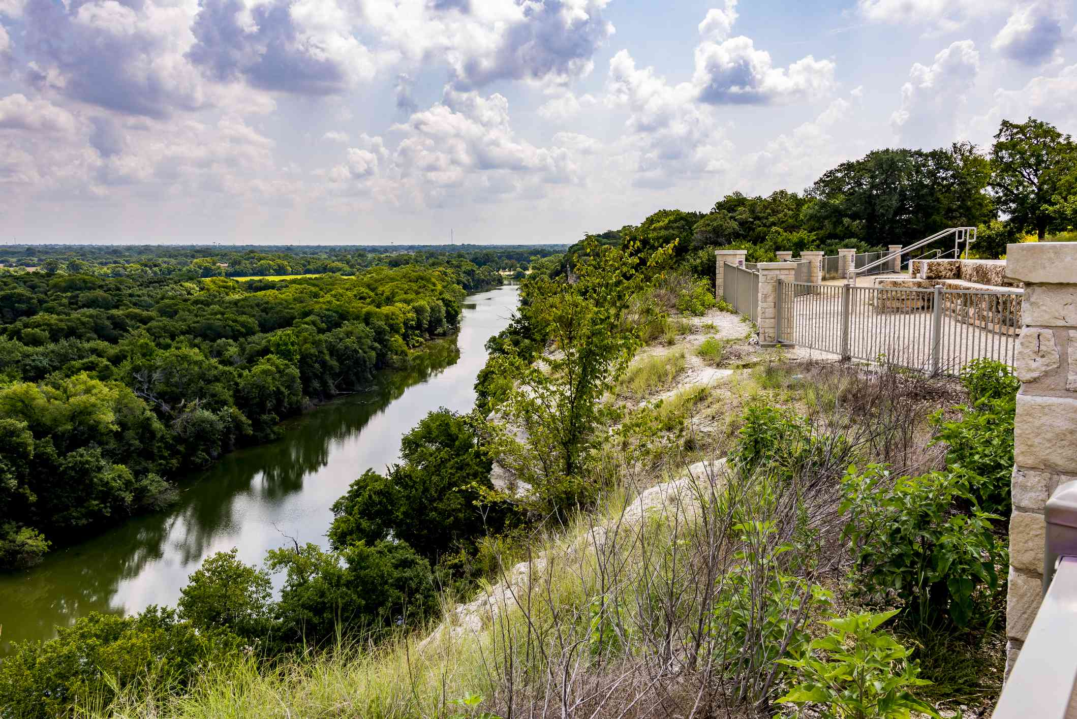The Brazos River and Texas Hill Country beyond, as seen from the area of Cameron Park cliffs known as Emmons Cliff.