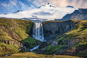 Waterfall Svoedufoss with Snaefellsjokull glacier in background, Olafsvik, West Iceland, Iceland