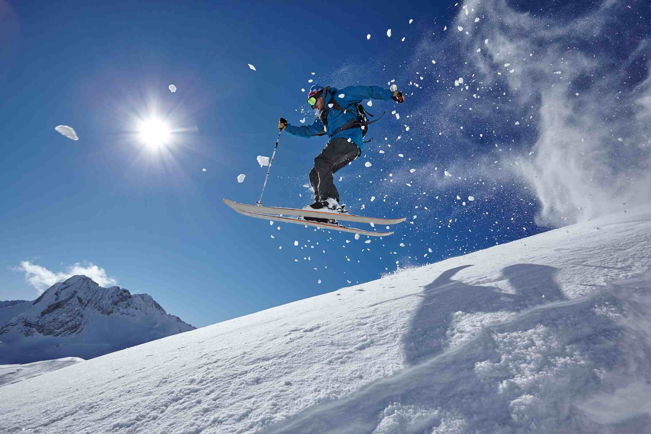 Male freestyle skier jumping mid air from mountainside, Zugspitze in Germany