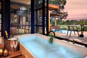 Hot tub with champagne next to it overlooking Sabi Sands