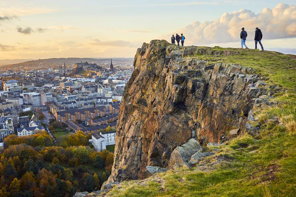 Salisbury Crags, Holyrood Park with Edinburgh city the in background at sunset