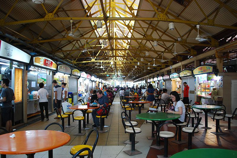 Interior of Maxwell Food Centre, a hawker center in Chinatown, Singapore.