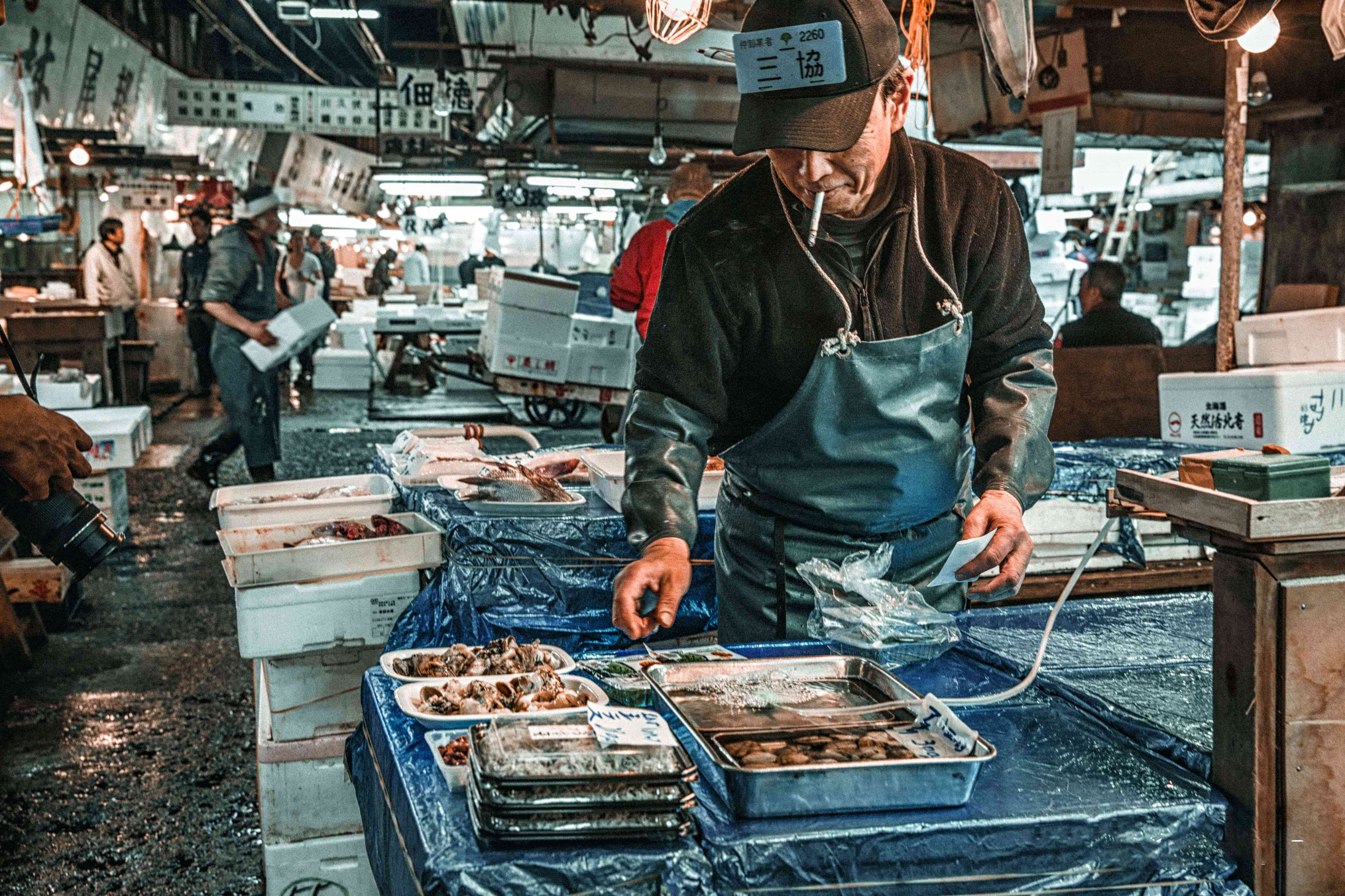 A man laying out fresh fish