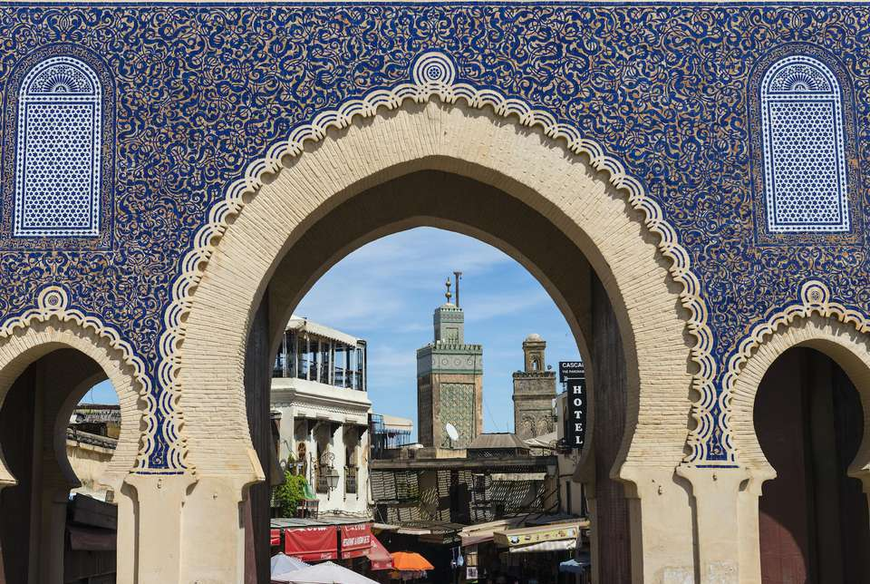 The minaret of Bou Inania Medersa visible through the medina gate, Fez