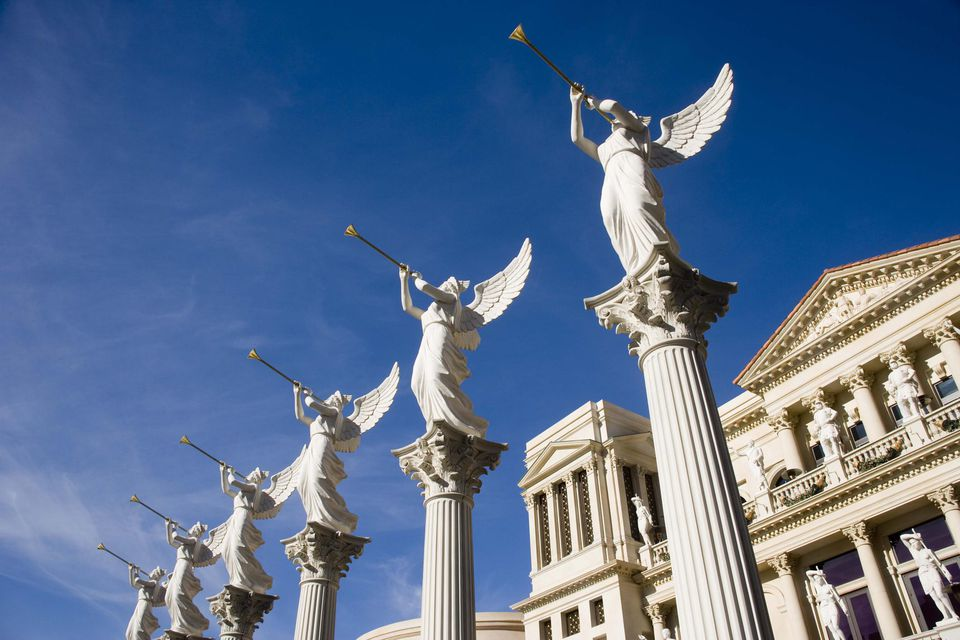 Statues of angels on columns by Las Vegas casino
