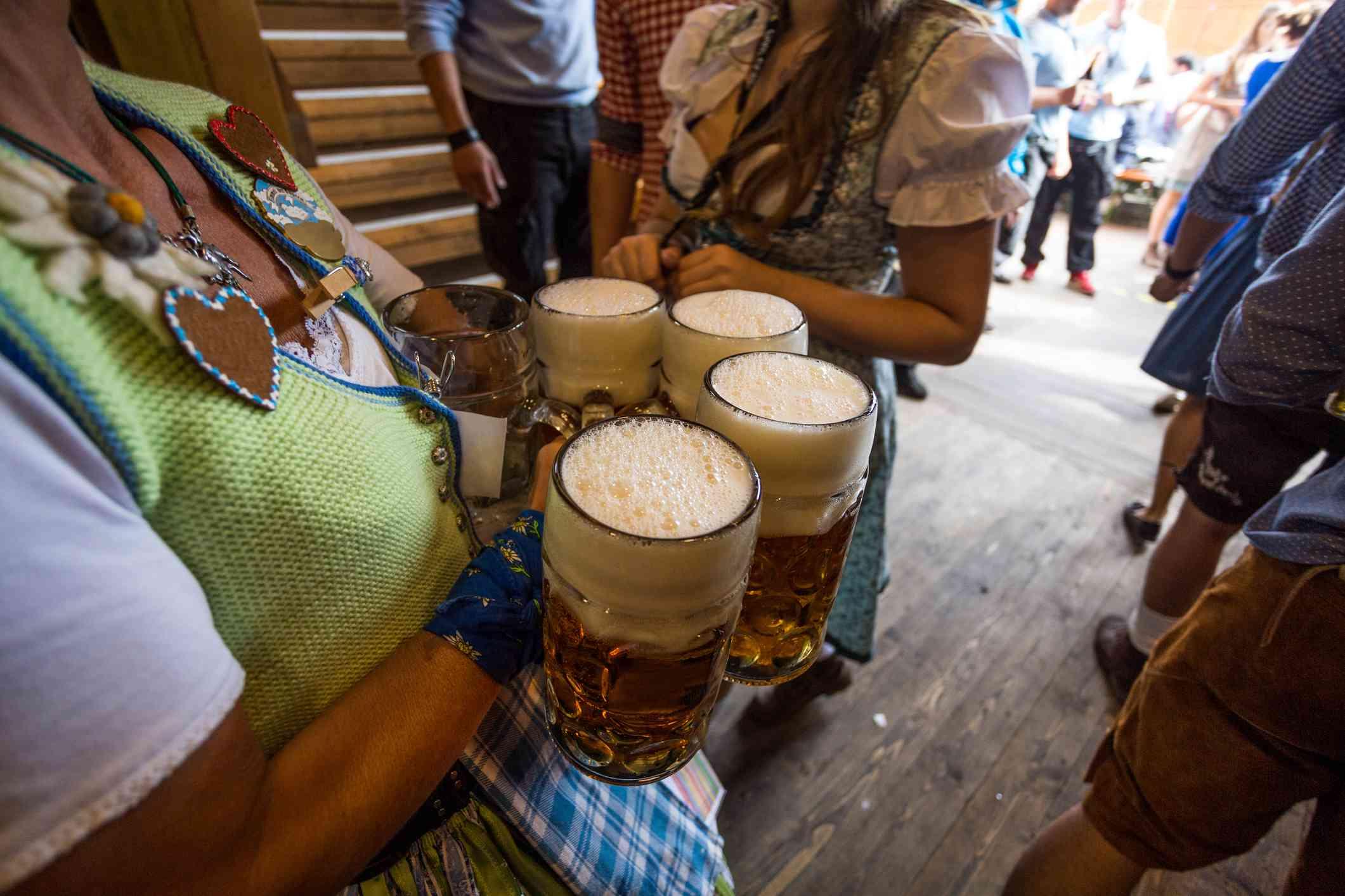 Waitresses serving beer at bar for Oktoberfest, Germany