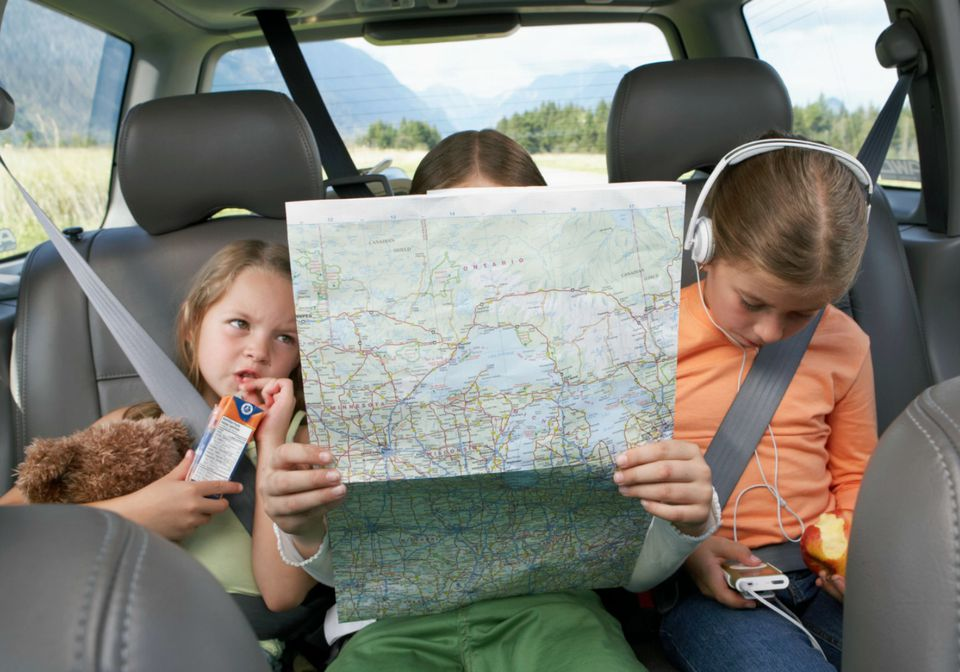 Kids in backseat on a family road trip