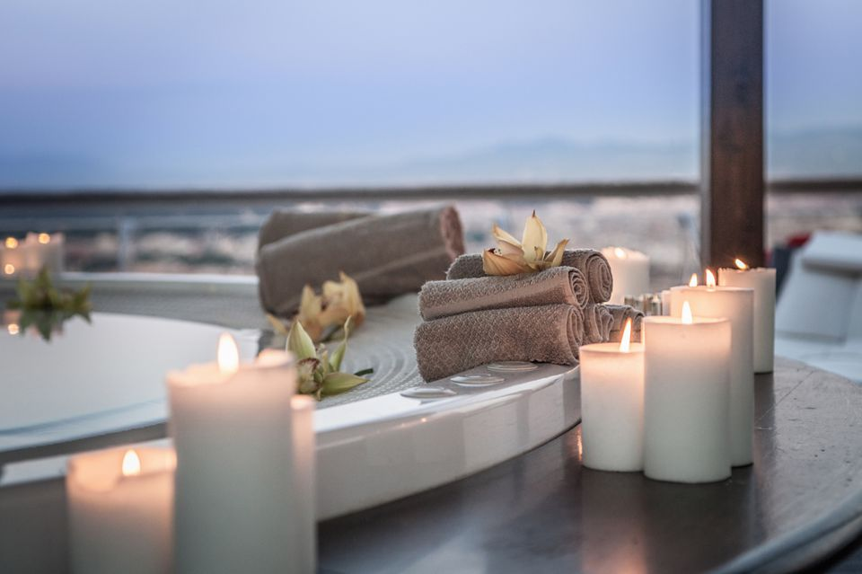 Candles on bath next to window with view