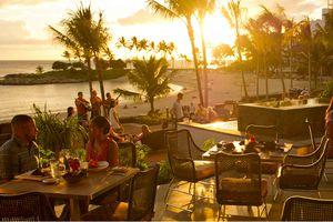Diners at the AMA'AMA restaurant at Aulani Resort, Hawaii
