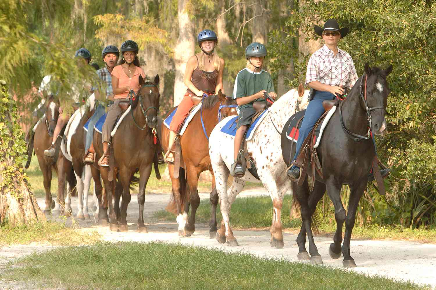 Guests horseback riding at Fort Wilderness Resort and Campground