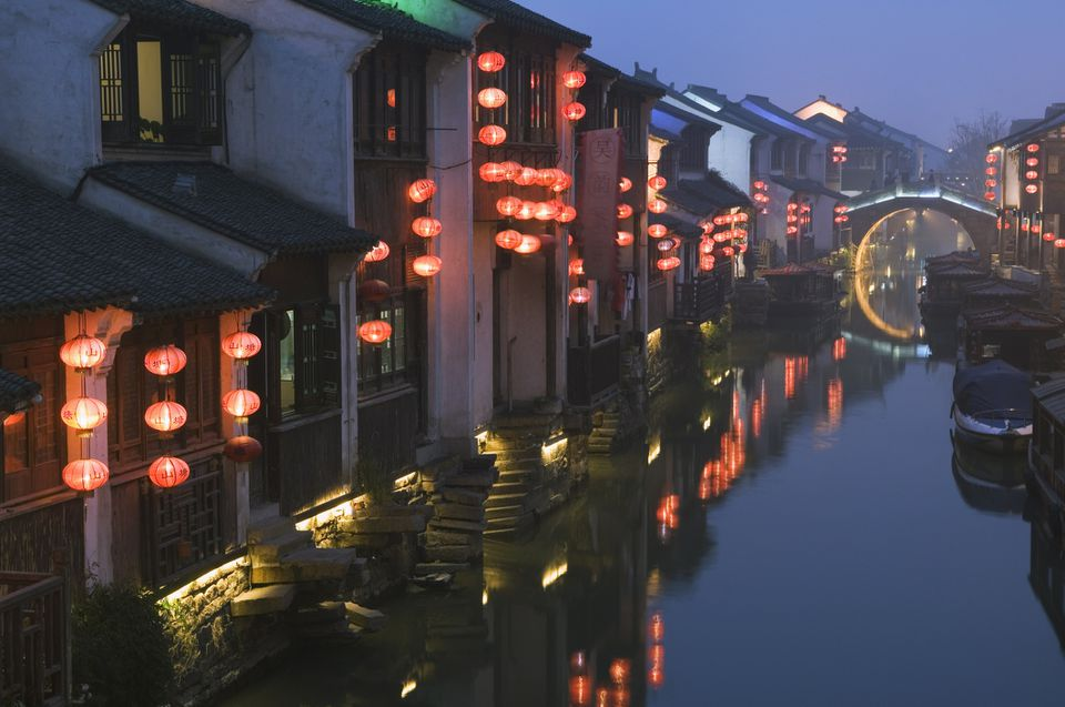 Traditional old riverside houses illuminated at night in Shantang water town, Suzhou, Jiangsu Province, China, Asia