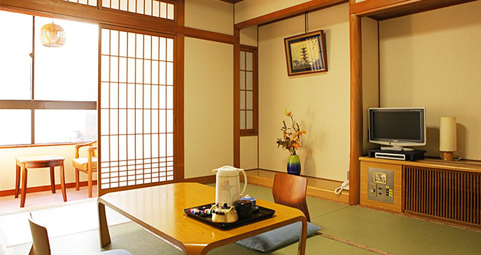 japanese style room with a low table and floor seats