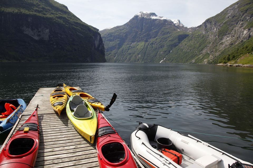 Kayaks in Norway at the Geiranger Fjord against a mountainous backdrop